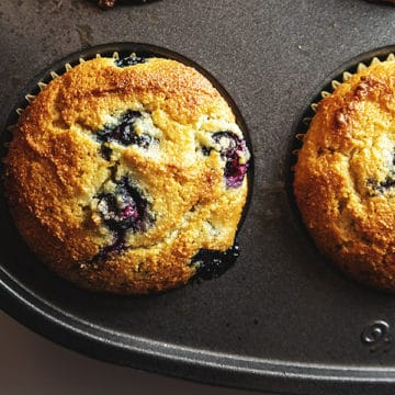 low carb blueberry muffins in a muffin tin