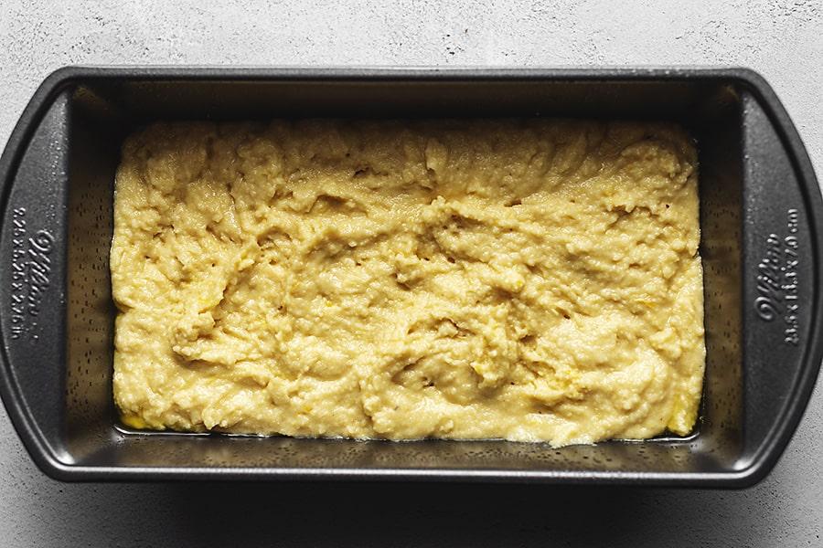 lemon pound cake batter in a loaf pan