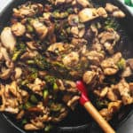 keto stir fry in a skillet with a red spatula