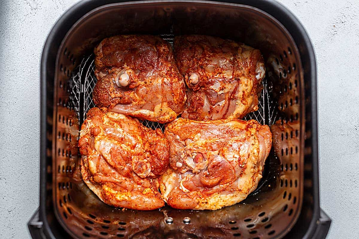 chicken thighs in the air fryer basket