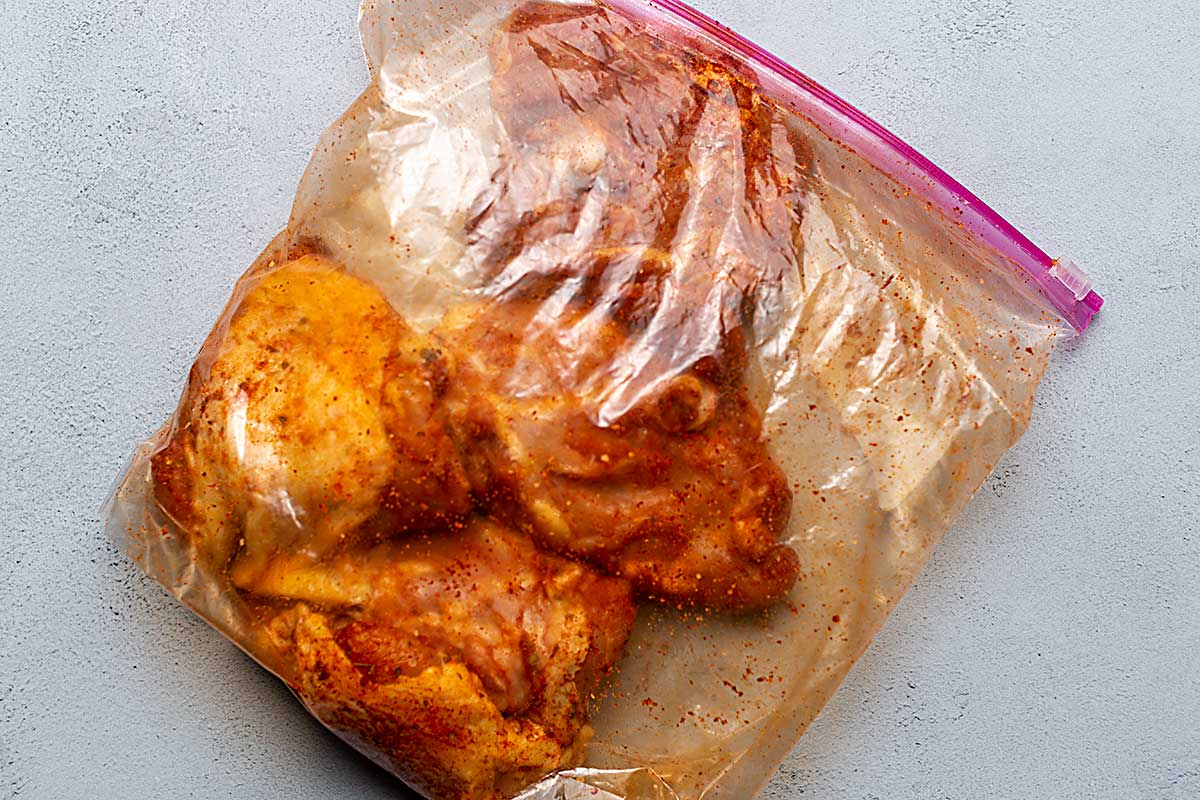 chicken thighs in a zip top bag with seasonings