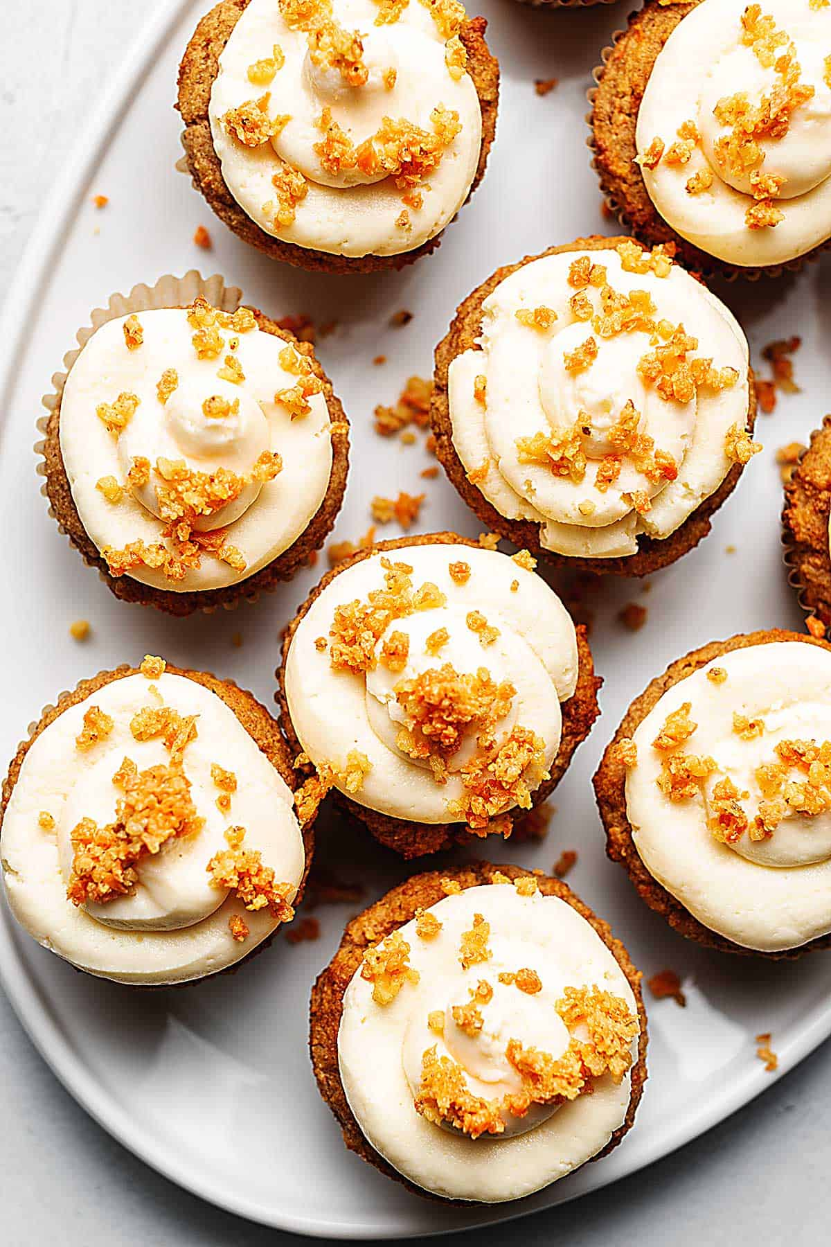 sugar free carrot cake cupcakes on a white platter