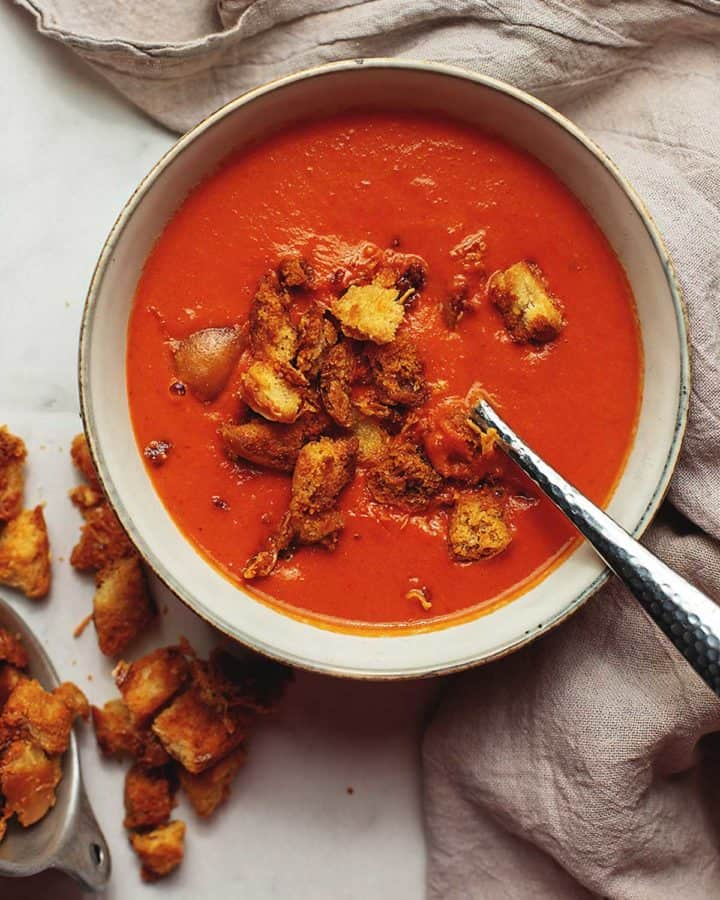low carb creamy tomato soup with croutons in a bowl
