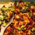 a wood spoon in broccoli casserole