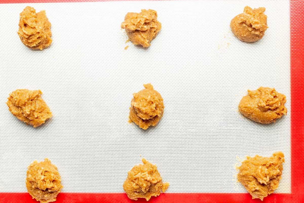 peanut butter cookie balls on a baking sheet.
