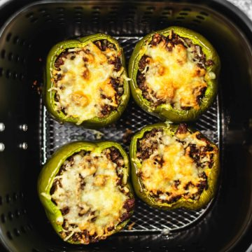 stuffed peppers in an air fryer basket