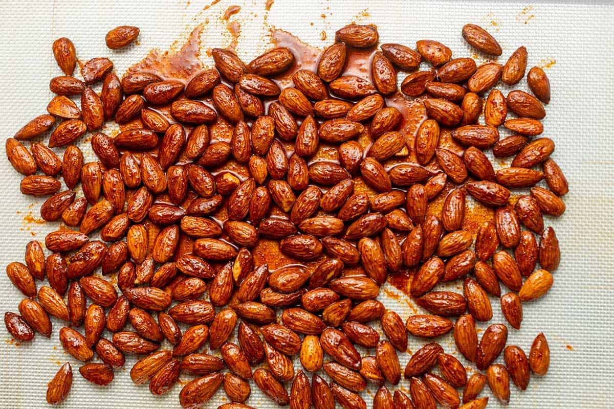 spiced almonds on a sheet tray