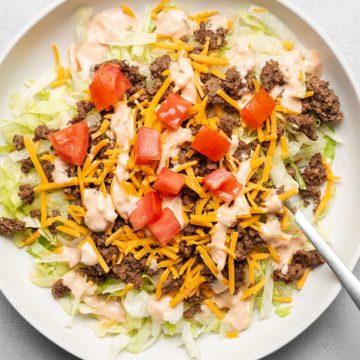 Big Mac salad in a white plate