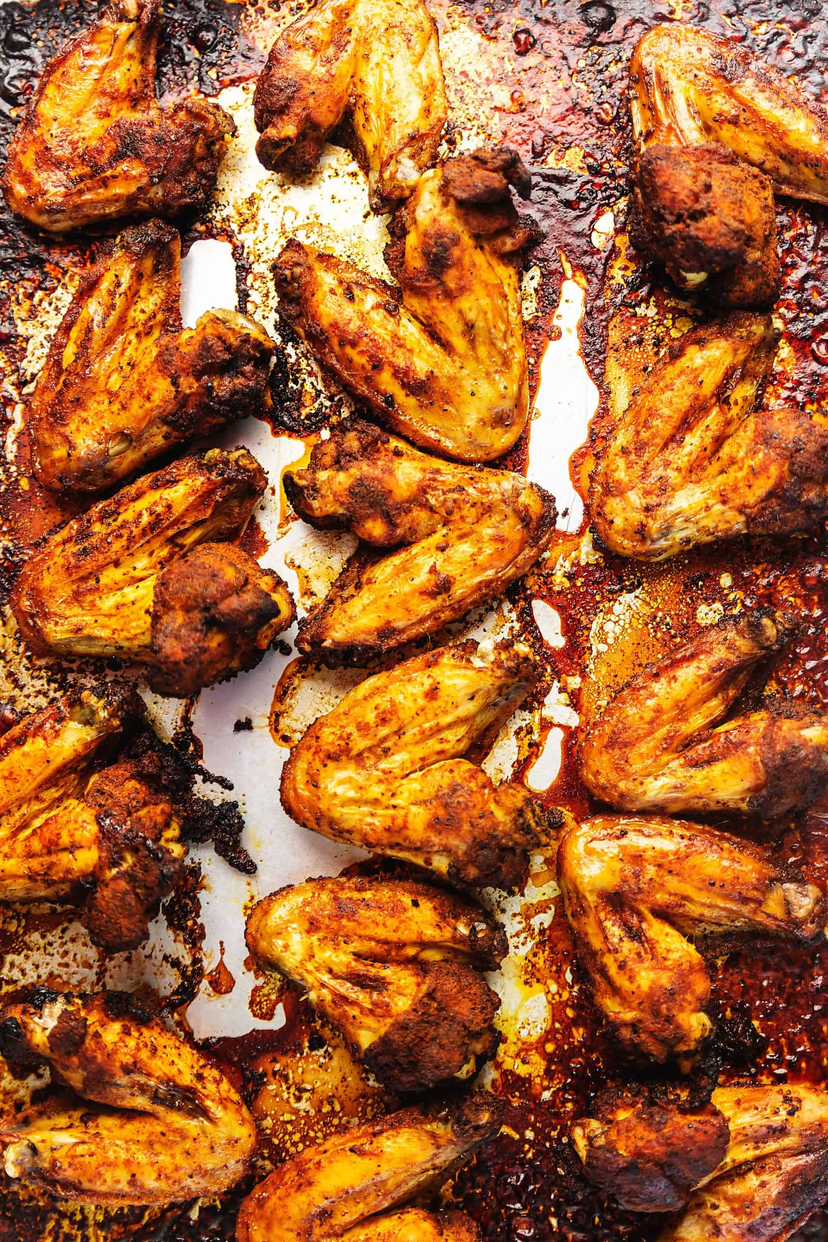 dry rubbed chicken wings cooked on a sheet tray