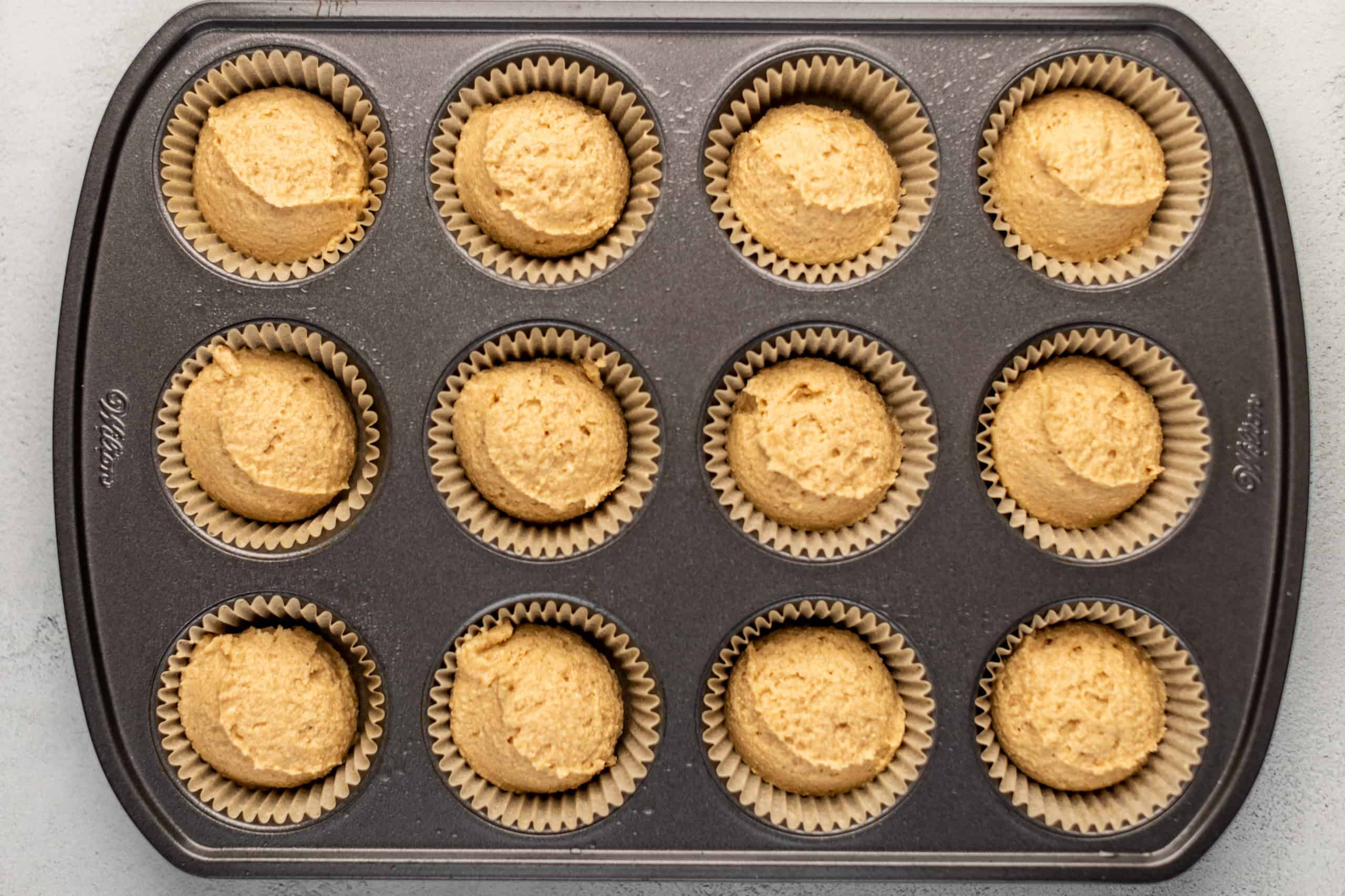 unbaked muffins in a muffin tin
