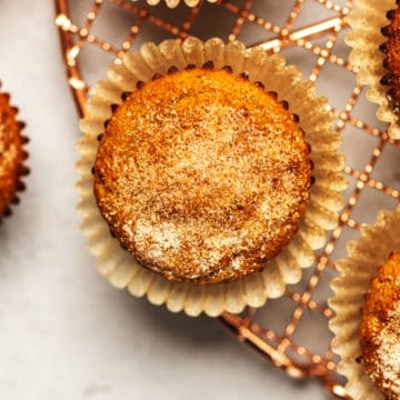keto apple cider donut muffins on a tray