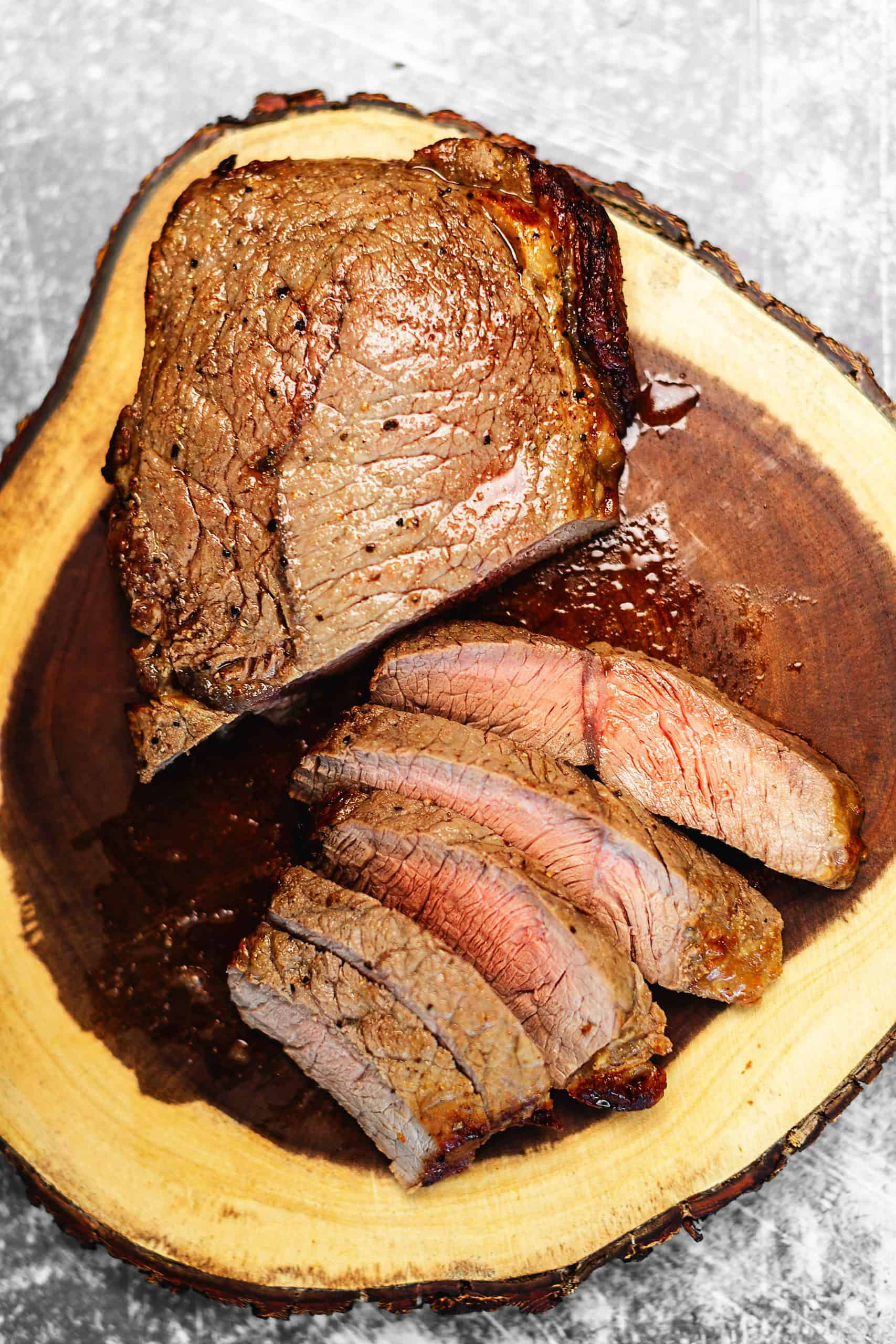 air fryer steak on a wood cutting board