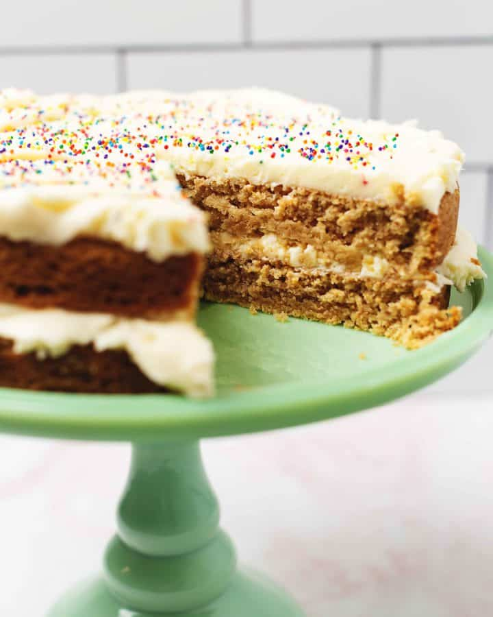 keto birthday cake on a stand