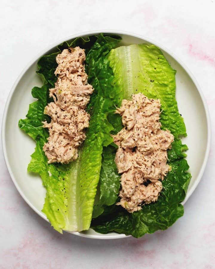tuna salad lettuce wraps on a white plate