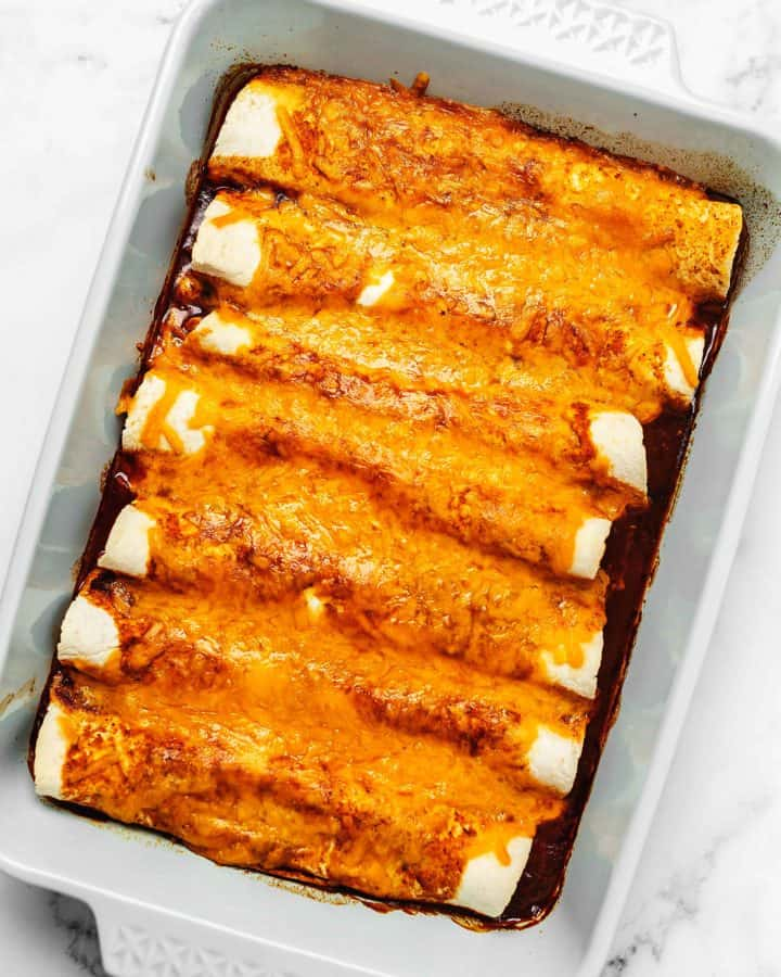 chicken enchiladas with sauce and cheese