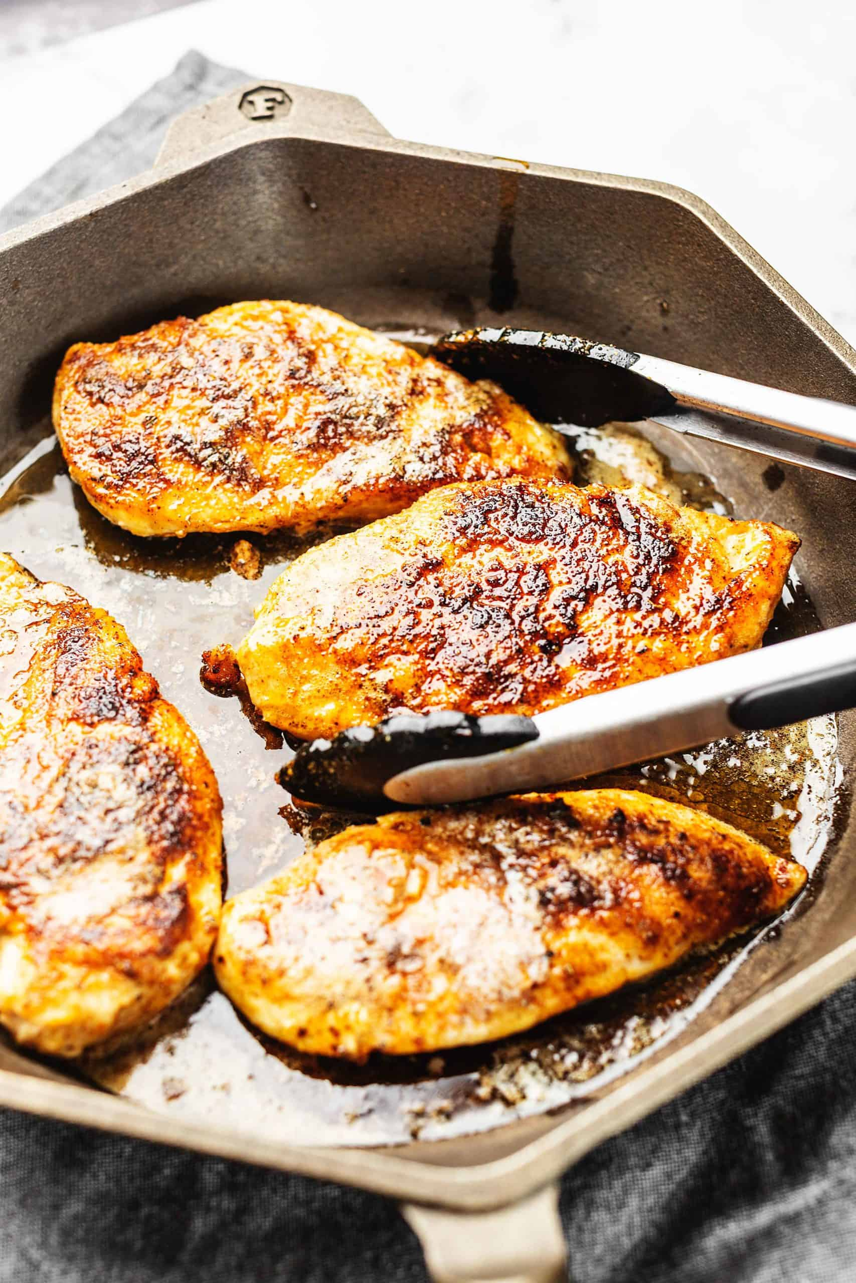 chicken breast cooked in a cast iron skillet