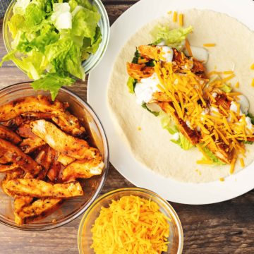 board of chicken wraps with buffalo sauce