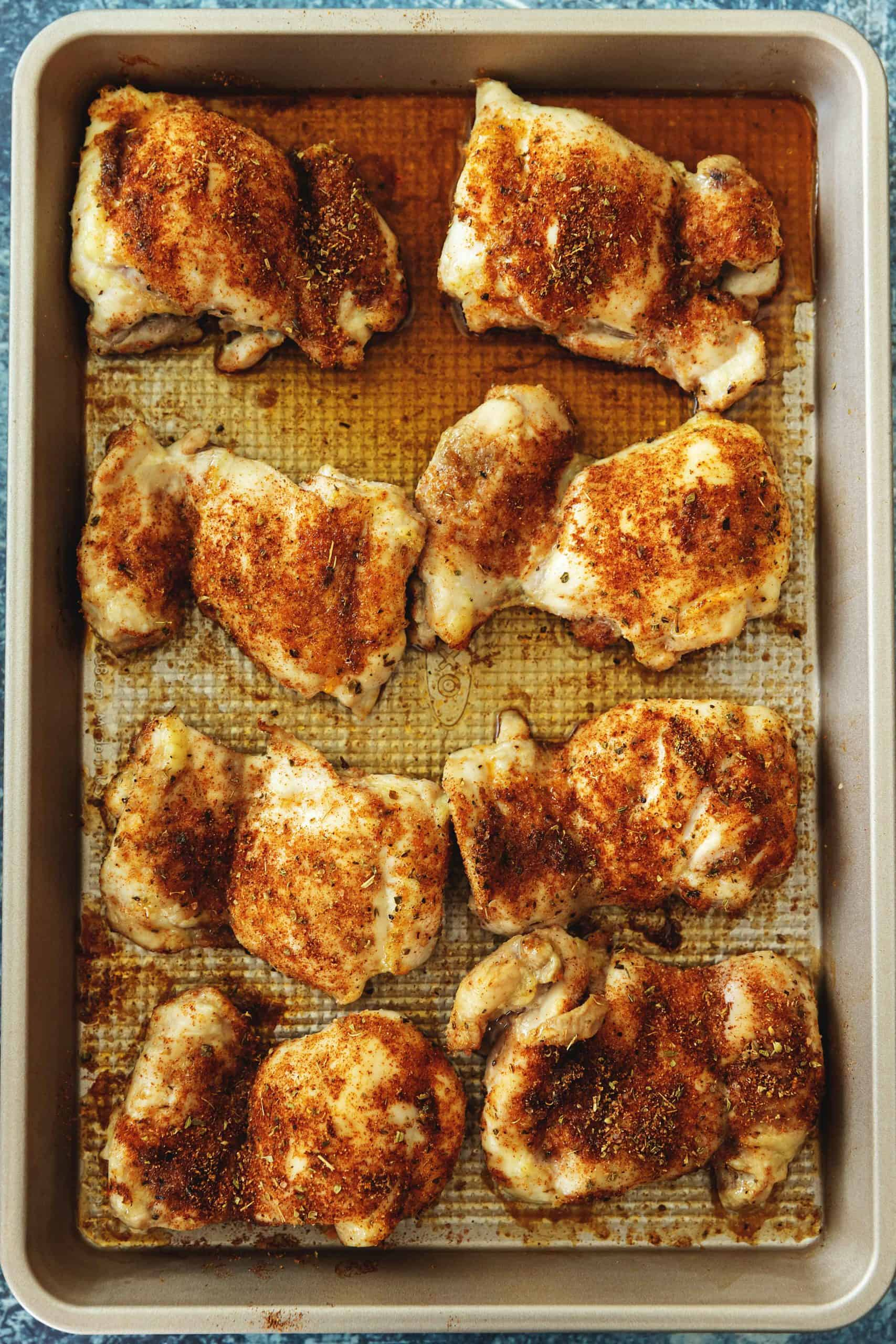 baked boneless skinless chicken thighs on a sheet tray
