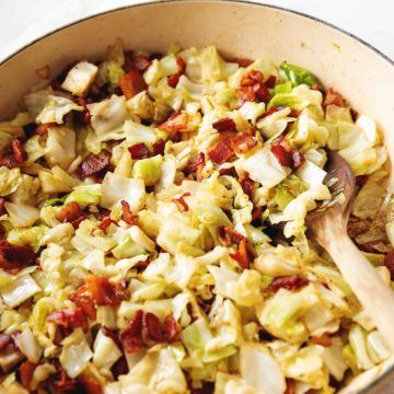 fried cabbage and bacon in a skillet